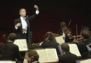 Italian conductor Claudio Abbado conducts the Berliner Philharmonic Orchestra during rehearsal in Ro..