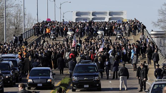 Vice President Joe Biden and other lawmakers leads a group across the Edmund Pettus Bridge in Selma, Ala., Sunday, March 3, 2013. They were commemorating the 48th anniversary of Bloody Sunday, when police officers beat marchers when they crossed the bridge on a march from Selma to Montgomery. (AP Photo/Dave Martin)