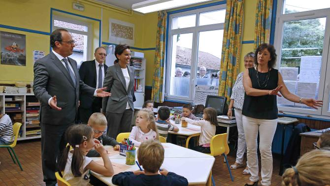 French President Hollande visits the Groupe Le Marais primary school on the first day of the new school year in Pouilly-sur-Serre