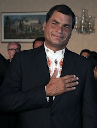 Ecuadorean President Rafael Correa celebrates re-election at the Carondelet presidential palace in Quito on February 17, 2013. Correa declared victory in the first-round of Ecuador&#39;s presidential vote Sunday as he celebrated with thousands of supporters in the capital of the South American country
