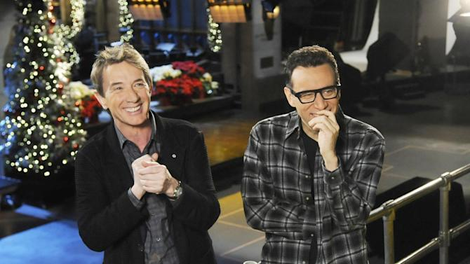 "This Dec. 11, 2012 photo released by NBC shows Martin Short, left, with cast member Fred Armisen on the set of ""Saturday Night Live,"" in New York. Short will guest host on the popular late night program along with musical guest Paul McCartney. (AP Photo/NBC, Dana Edelson)"