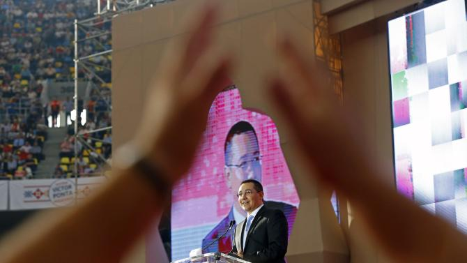 Ponta, Romania's Prime Minister and leader of Social Democrat ruling party, addresses his supporters during a rally at the National Arena stadium in Bucharest