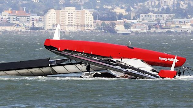"The Artemis Racing yacht is towed to shore after capsizing in the San Francisco Bay, California May 9, 2013. British yacht-racing champion Andrew ""Bart"" Simpson, who won a gold medal at the 2008 Summer Olympics in Beijing Reuters"