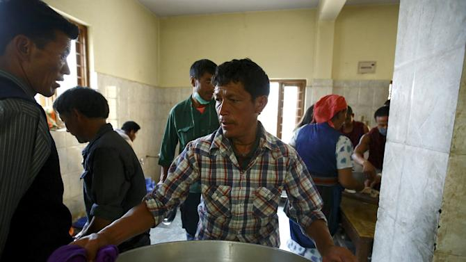 Volunteers works to prepare food for the earthquake victims from Langtang district at a Tibetan Monastery