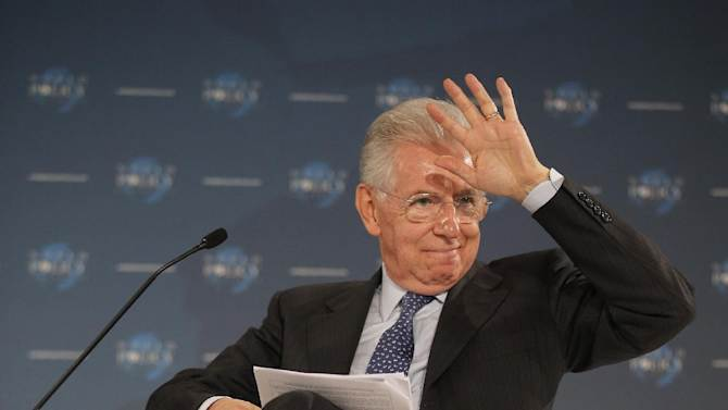 Prime Minister of Italy Mario Monti gestures during the World Policy conference in Cannes, southern France, Saturday, Dec. 8, 2012.(AP Photo/Lionel Cironneau)