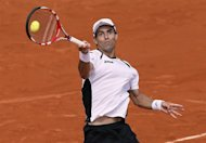 Colombia's Santiago Giraldo hits a return to Britain's Andy Murray during their Men's Singles third Round tennis match of the French Open tennis tournament at the Roland Garros stadium, on June 2, 2012 in Paris. AFP PHOTO / PATRICK KOVARIK