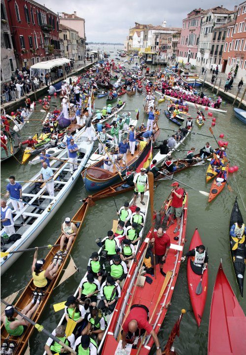 Rowers take part in the Vogalonga, or long row, in the Grand Canal in the Venice lagoon