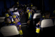 "Member of the murga ""Los amantes de La Boca"" wait inside a bus before heading to carnival celebrations in Buenos Aires, Argentina, Saturday, Feb. 2, 2013. Argentina's carnival celebrations may not be as well-known as the ones in neighboring Uruguay and Brazil, but residents of the nation's capital are equally passionate about their ""murgas,"" or traditional musical troupes. The murga ""Los amantes de La Boca,"" or ""The Lovers of The Boca"" is among the largest, with about 400 members. It's a reference to the hometown Boca Juniors, among the most popular soccer teams in Argentina and the world. (AP Photo/Natacha Pisarenko)"