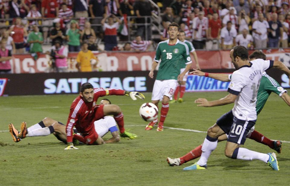United States' Landon Donovan, right, scores a goal as Mexico goalkeeper Jose de Jesus Corona watches during the second half of a World Cup qualifying soccer match Tuesday, Sept. 10, 2013, in Columbus, Ohio. (AP Photo/Jay LaPrete)
