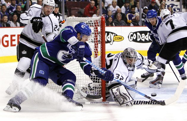 Vancouver Canucks' Burrows is stopped by Los Angeles Kings goaltender Quick during their NHL hockey game in Vancouver