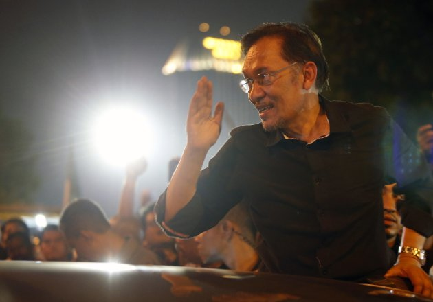 Malaysia's opposition leader Anwar Ibrahim gestures to his supporters as he leaves a protest against recent election results outside Kuala Lumpur