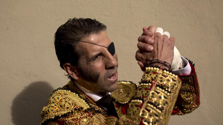 Spanish bullfighter Jose Padilla gestures during a bullfight of the San Fermin festival in Pamplona, Spain, Saturday, July 12, 2014. Revelers from around the world arrive to Pamplona every year to take part in some of the eight days of the running of the bulls. (AP Photo/Andres Kudacki)