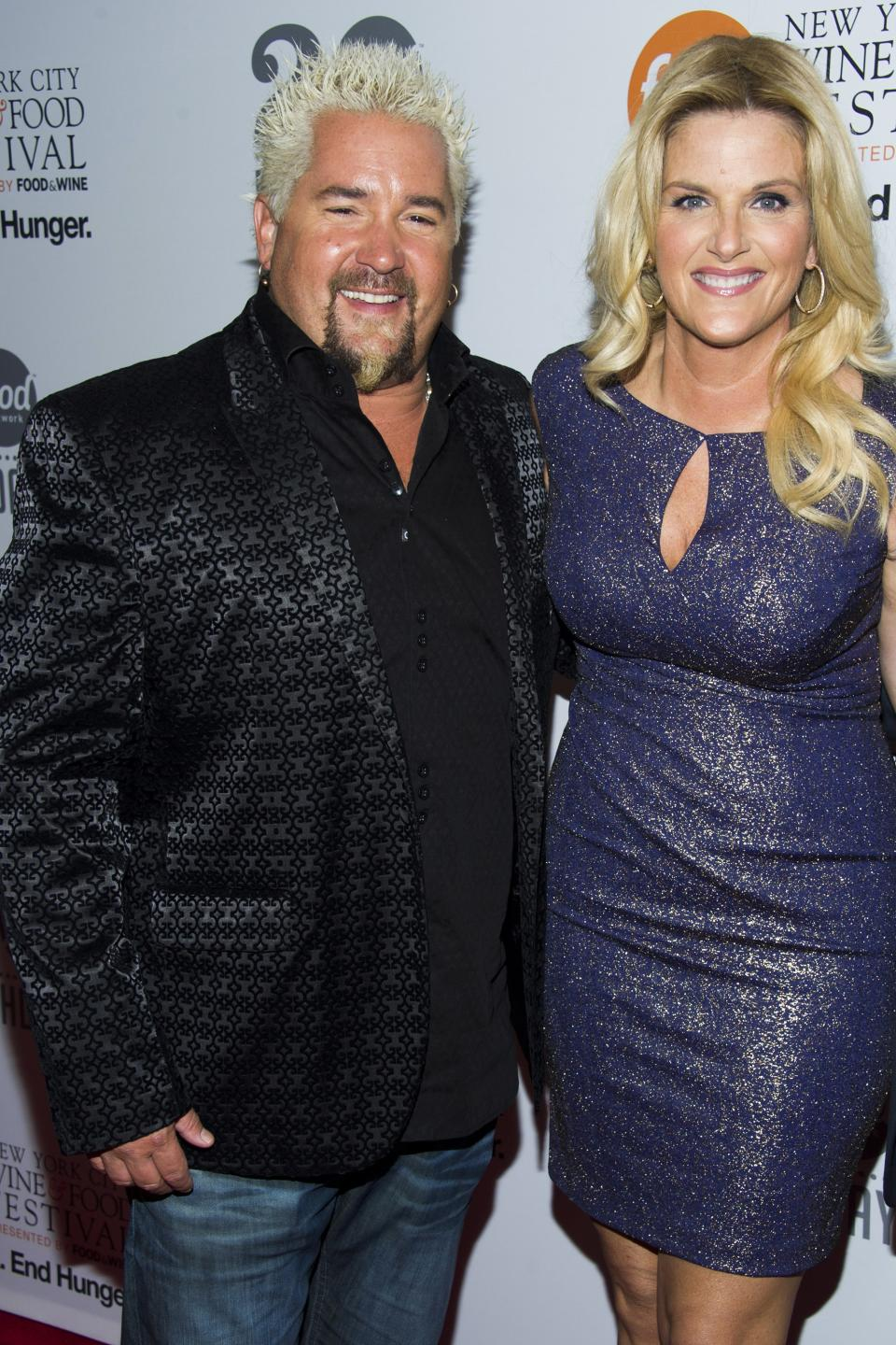 Guy Fieri, right, and Trisha Yearwood attend the Food Network's 20th birthday party on Thursday, Oct. 17, 2013, in New York. (Photo by Charles Sykes/Invision/AP)