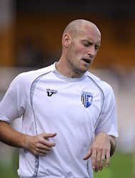 Adam Barrett's header rescued Gillingham