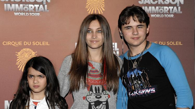 FILE - This Jan. 27, 2012 file photo shows, from left, Blanket Jackson, Paris Jackson, and Prince Michael Jackson at the opening night of the Michael Jackson The Immortal World Tour in Los Angeles. Paris Jackson is physically fine after being taken to a hospital early Wednesday, June 5, 2013, an attorney for Jackson's mother said. Perry Sanders Jr. writes in a statement that Paris Jackson is getting appropriate medical attention and the family is seeking privacy. Fire and sheriff's officials confirmed they transported someone from a home in Paris' suburban Calabasas neighborhood for a possible overdose but did not release any identifying information or additional details. (AP Photo/Dan Steinberg, file)