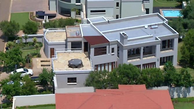 This aerial image taken from video provided by VNS24/7 on Thursday Feb. 14, 2013, shows the home of Olympic athlete Oscar Pistorius in a gated housing complex in Pretoria, South Africa. Olympic athlete Oscar Pistorius has been arrested in the shooting death of his girlfriend, police and the woman's talent agent said Thursday. (AP Photo/VNS24/7)