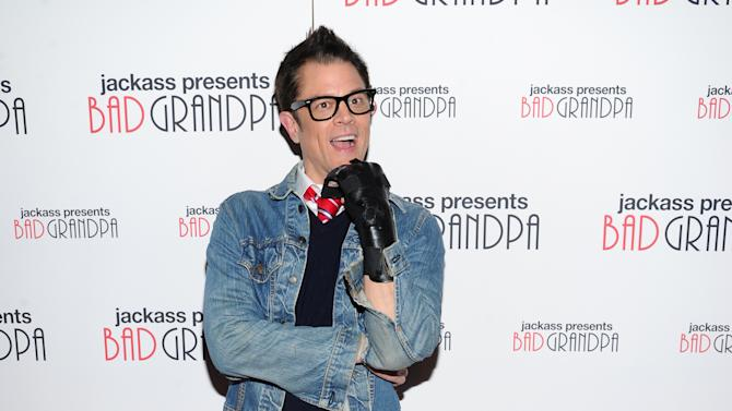 "File-This Oct. 21, 2013 file photo shows actor Johnny Knoxville attending a special screening of ""Jackass Presents: Bad Grandpa"" at the Sunshine Landmark Theater in New York. Paramount's ""Jackass Presents: Bad Grandpa"" topped the weekend box office with $32 million, according to studio estimates Sunday, sinking three-week champ ""Gravity"" to second place. (Photo by Evan Agostini/Invision/AP, File)"