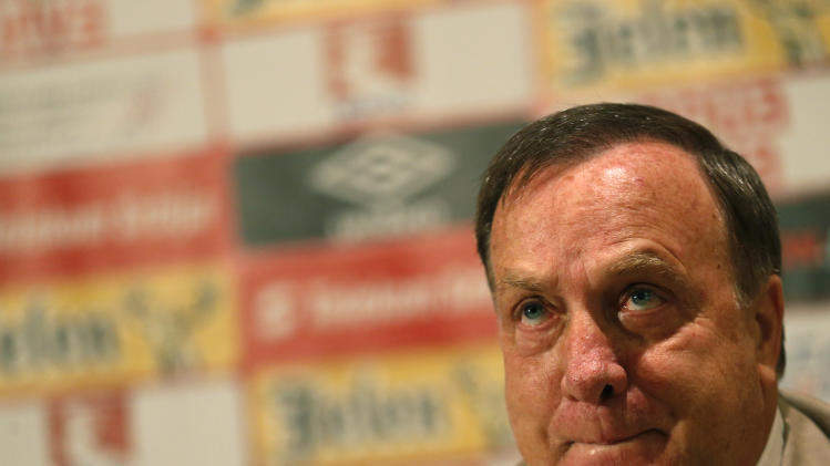Serbian national soccer team coach Dick Advocaat listens to questions during a press conference in Belgrade, Serbia, Friday, Aug 29, 2014. Serbia will face France on Sunday, Sept. 7, in a friendly match in Belgrade. (AP Photo/Darko Vojinovic)