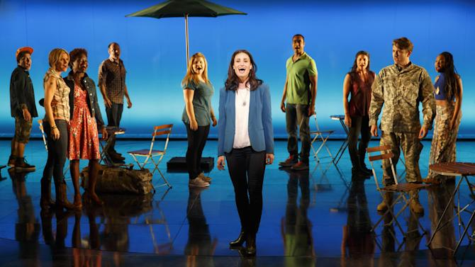 """This Nov. 4, 2013, image released by The National Theatre shows Idina Menzel as Elizabeth and the Company of the original musical If/Then at the National Theatre in a scene of the world premiere of the original musical in Washington. Although long neglected and underused — and left dark for all but five weeks last year — the National Theatre is opening its first season under new management with a show that's already generating plenty of buzz. """"If/Then,"""" which reunites Idina Menzel, and director Michael Greif from """"Rent,"""" is in the midst of its pre-Broadway tryout after weeks of technical rehearsals and tweaks.(AP Photo/National Theatre, Joan Marcus)"""