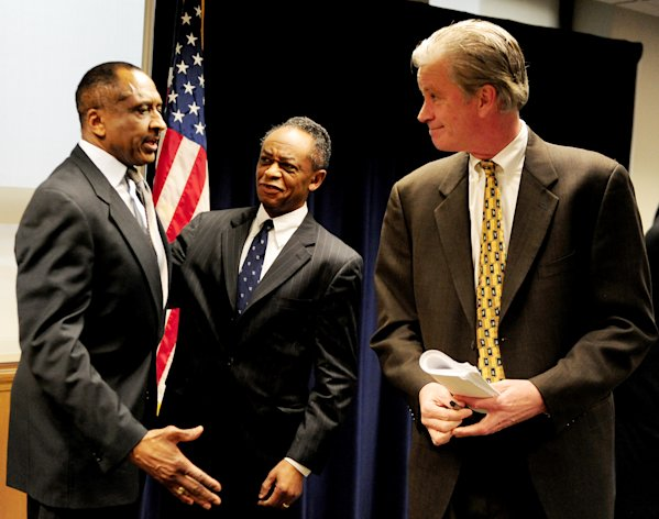From left, Ronald Goldsberry, independent consultant, Frederick Headen, Legal Advisor for Michigan Department of Treasury and Michigan State Treasurer Andy Dillon speak at a news conference in Detroit, Tuesday, Feb. 19, 2013. (AP Photo/The Detroit News, Ricardo Thomas)