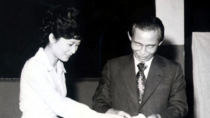 FILE - In this 1977 file photo, then South Korean President Park Chung-hee, right, and his daughter, Park Geun-hye, cast ballots in Seoul, South Korea. Park Geun-hye was elected the country's first female president Wednesday, Dec. 19, 2012, a landmark win that could mean a new drive to start talks with rival North Korea. (AP Photo/Yonhap, File) KOREA OUT