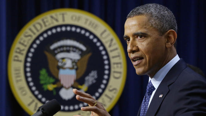 "President Barack Obama gestures as he speaks about the fiscal cliff, Monday, Dec. 31, 2012, in the South Court Auditorium at the White House in Washington. The president said it appears that an agreement to avoid the fiscal cliff is ""in sight,"" but says it's not yet complete and work continues.  (AP Photo/Charles Dharapak)"