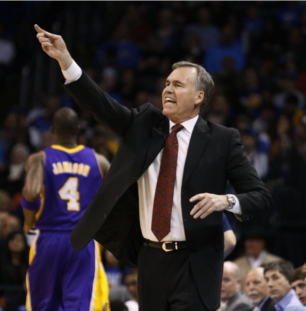 Los Angeles Lakers head coach Mike D'Antoni shouts instructions to his team against the Oklahoma City Thunder in Oklahoma City