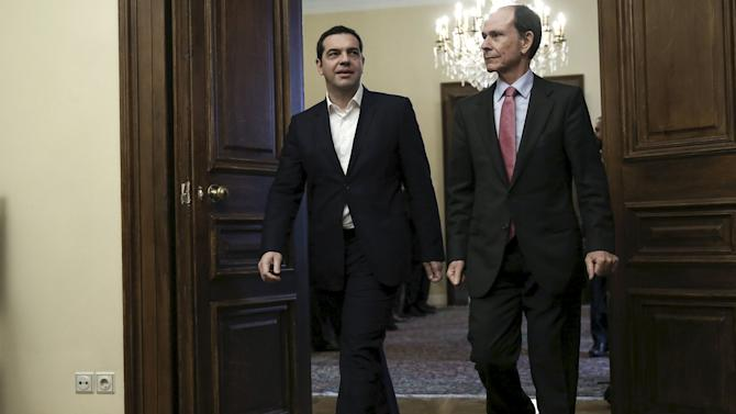 Greek PM Tsipras arrives for a meeting of political party leaders at the Presidential Palace