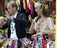 "Prince William and Catherine dance during a singing and dancing event in Tuvalu on September 18. The pair jetted out of the tiny Pacific nation just hours after French authorities ordered the magazine Closer to hand over all forms of the ""particularly intrusive"" pictures to the royal couple"