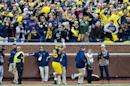 FILE - In this Oct. 17, 2015, file photo, Michigan linebacker Joe Bolden (35) gestures as he runs off the field after being ejected for a targeting penalty in the second quarter of an NCAA college football game against Michigan State, in Ann Arbor, Mich. The NCAA football rules committee has proposed giving video replay officials more authority to overturn incorrect targeting fouls and call targeting penalties when they are missed on the field. The rules committee completed four days of meetings in Orlando, Florida, on Thursday, Feb. 11, 2016, and announced several proposals that could be implemented next season if approved by the playing rules oversight panel on March 8. (AP Photo/Tony Ding, File)