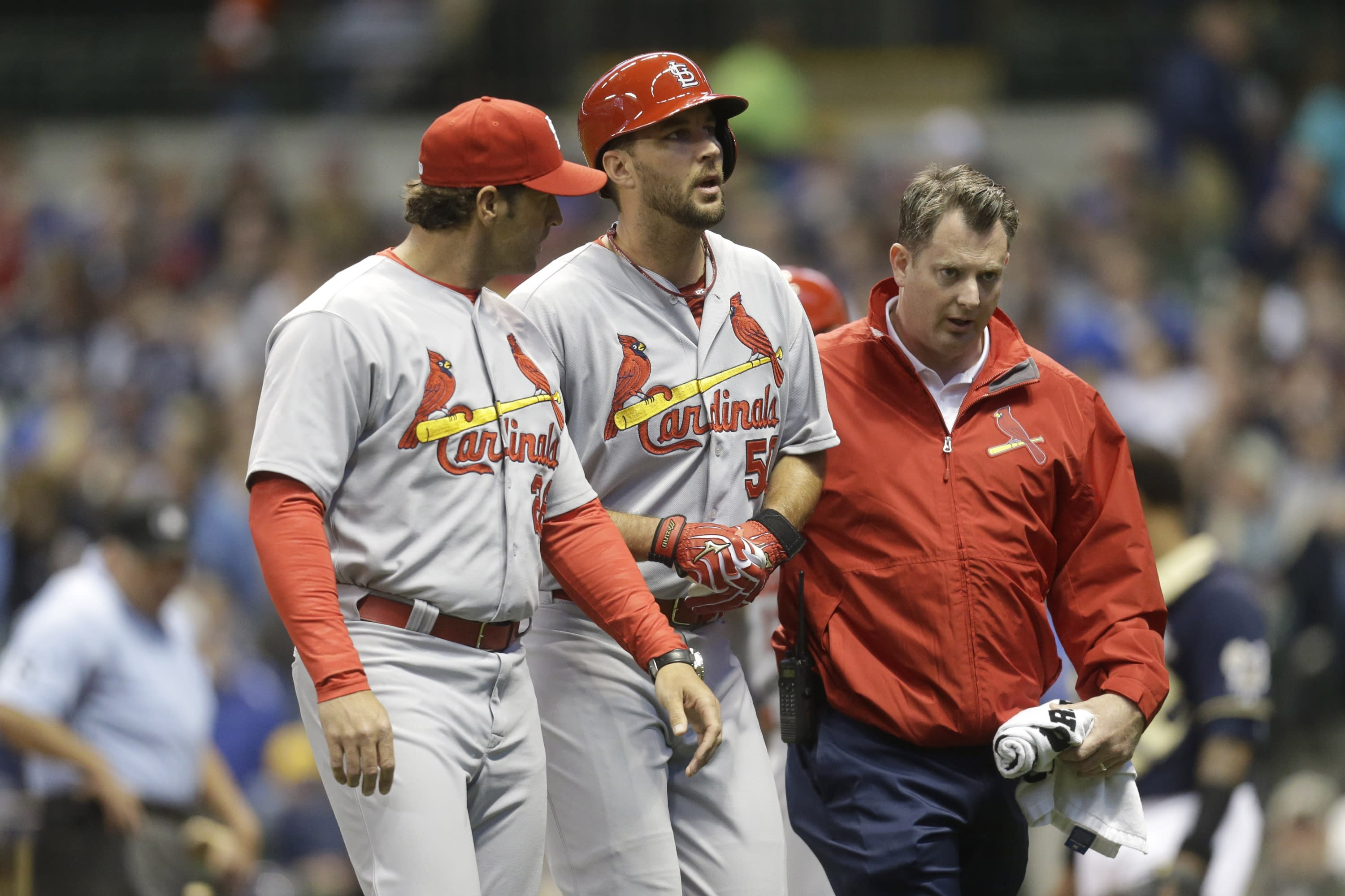 Adam Wainwright leaves game with left ankle injury suffered while batting