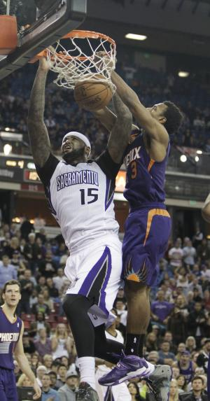 Cousins' double-double rallies Kings past Suns