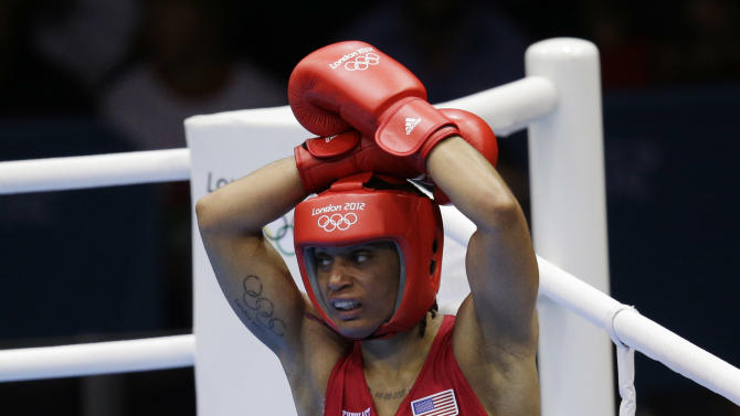 Quanitta Underwood of the United States, reacts after her fight against Natasha Jonas of Great Britain, during the women's lightweight boxing competition at the 2012 Summer Olympics, Sunday, Aug. 5, 2012, in London. (AP Photo/Patrick Semansky)
