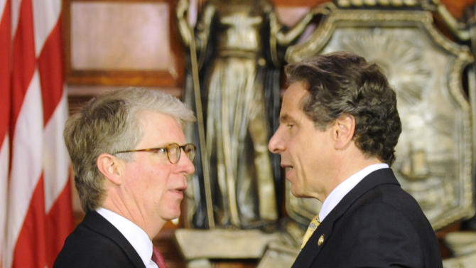 New York Gov. Andrew Cuomo, right, thanks New York County District Attorney Cy Vance, following a news conference at the Capitol in Albany, N.Y., on Monday, June 4, 2012.  Cuomo is proposing the decriminalization of the possession of small amounts of marijuana in public view. (AP Photo/Tim Roske)