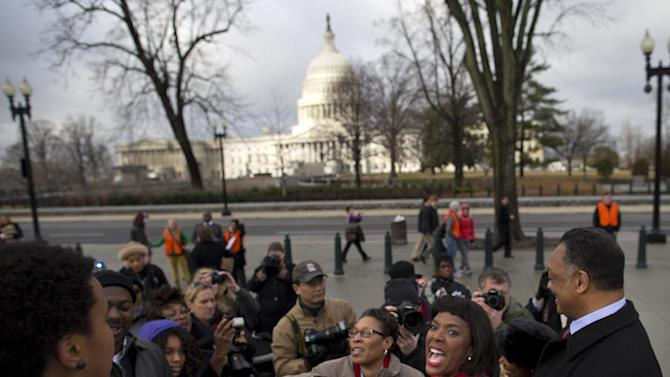 Rep. Terri Sewell, D-Ala., second from right, and Rev. Jesse Jackson, right, greet people waiting in line outside the Supreme Court in Washington, Wednesday, Feb. 27, 2013, to listen to arguments in the Shelby County, Ala., v. Holder voting rights case. The justices are hearing arguments in a challenge to the part of the Voting Rights Act that forces places with a history of discrimination, mainly in the Deep South, to get approval before they make any change in the way elections are held. (AP Photo/Evan Vucci)
