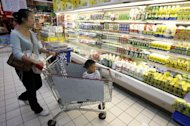 A Chinese mother shops with her child for dairy products at a supermarket