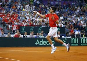 Serbia's Djokovic returns the ball to Canada's Raonic during their Davis Cup semi-final tennis match in Belgrade