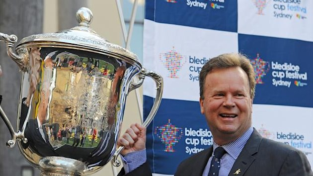 Australian Rugby Union chief executive officer Bill Pulver poses with the Bledisloe Cup during the official Bledisloe Cup Festival launch in Sydney on August 9, 2013 (AFP)