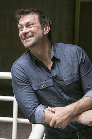 In this Thursday, March 28, 2013, photo Australian actor Grant Bowler poses for a photo in Los Angeles. Bowler plays Joshua Nolan, the local lawman in a border town known as Defiance. The series Defiance will be broadcast on April 15 on the cable channel Syfy. (AP Photo/Damian Dovarganes)