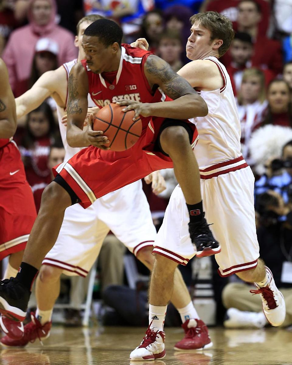 Ohio State's Lenzelle Smith Jr., center, grabs a rebound against Indiana's Jordan Hulls during the second half of an NCAA college basketball game, Tuesday, March 5, 2013, in Bloomington, Ind. Ohio State won 67-58. (AP Photo/Darron Cummings)