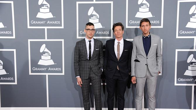 Musical group fun., from left, Jack Antonoff, Nate Ruess and Andrew Dost arrive at the 55th annual Grammy Awards on Sunday, Feb. 10, 2013, in Los Angeles.  (Photo by Jordan Strauss/Invision/AP)