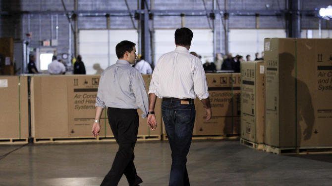 Republican presidential candidate, former Massachusetts Gov. Mitt Romney, right, walks with Sen. Marco Rubio, R-Fla., after talking to reporters prior to a town hall-style meeting in Aston, Pa., Monday, April 23, 2012. (AP Photo/Jae C. Hong)