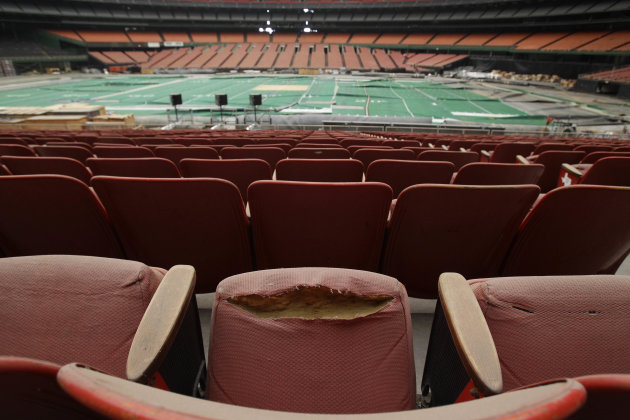 FILE - In this May 21, 2012, file photo, rows of dirty, tattered seats ring the Astrodome in Houston. Once touted as the Eighth Wonder of the World, the nation's first domed stadium sits quietly gathe