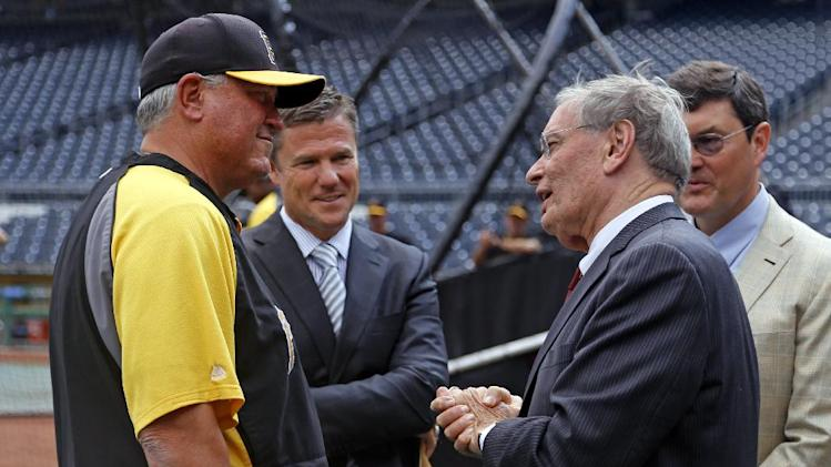 Commissioner of Major League Baseball, Bud Selig, right front, visits with manager Clint Hurdle, left, as he tours PNC Park with Pirates Chairman of the Board Bob Nutting, right rear, and Pirates' President Frank Coonelly, second from right, before a baseball game between the Pittsburgh Pirates and the Los Angeles Dodgers in Pittsburgh Tuesday, July 22, 2014. (AP Photo)
