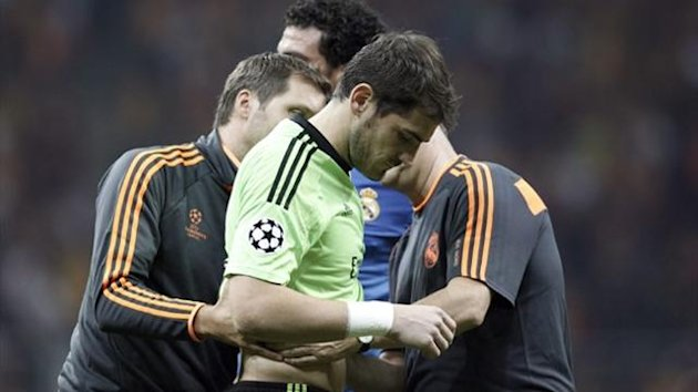 Real Madrid's goalkeeper Iker Casillas reacts to his injury during their Champions League Group B match against Galatasaray (Reuters)