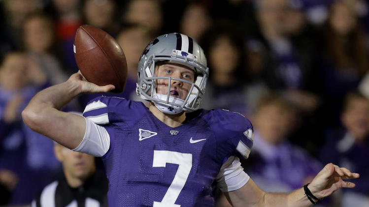 Kansas State quarterback Collin Klein throws during the first half of an NCAA college football game against Texas, Saturday, Dec. 1, 2012, in Manhattan, Kan. (AP Photo/Charlie Riedel)