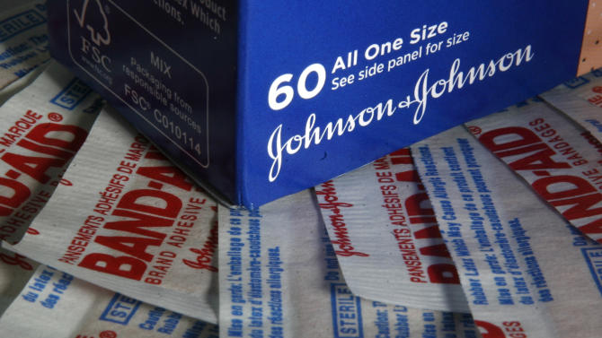 Johnson & Johnson Band-Aid products are seen on Monday, Jan. 24, 2011 in Montpelier, Vt. Health care giant Johnson & Johnson, hammered by numerous recalls that have kept some products off the market, posts a 5.5 percent drop in sales Tuesday, Jan. 25, and a 12 percent drop in profit in the fourth quarter.(AP Photo/Toby Talbot)