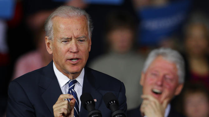 Former president Bill Clinton laughs as Vice President Joe Biden speaks during a campaign rally at the Covelli Centre, Monday, Oct. 29, 2012, in Youngstown, Ohio. (AP Photo/Matt Rourke)