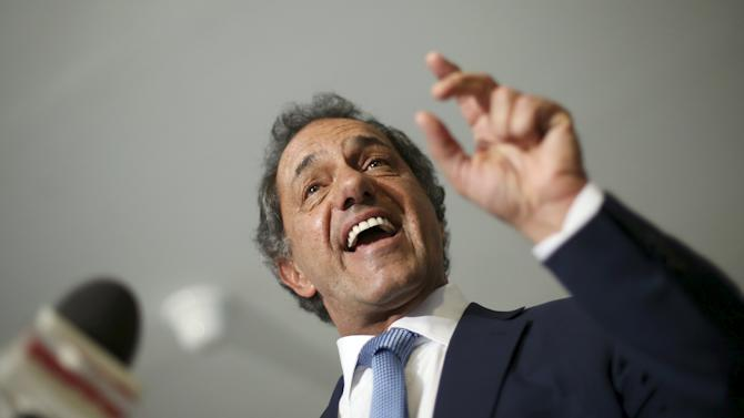 Scioli, Buenos Aires' province governor and presidential candidate for the Front for Victory, talks with journalists after a meeting with Brazilian President Rousseff at the Planalto Palece in Brasilia