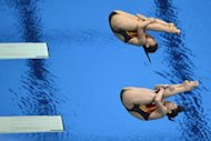 China&#39;s Wu Minxia and He Zi dive during the women&#39;s synchronised 3m springboard diving event at the London 2012 Olympic Games in London. Wu and He won gold